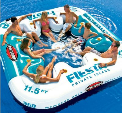 "Sportsstuff Fiesta party raft in a lake with 7 adults. Blue and white 11.5"" big."
