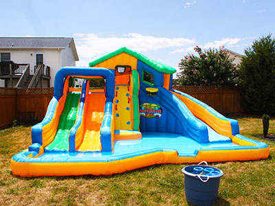 A giant water inflatable slide with 4 different slides. How amazin is this? I want one.