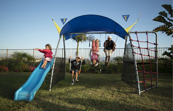 For active kids, this is a great playset. It's not just a swing and a slide, it also has a sprayer that you can attach to a hose in the summer. What a great way to keep cool.